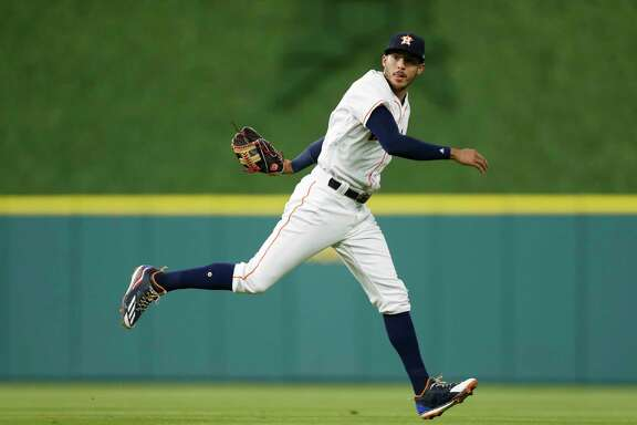 Houston Astros shortstop Carlos Correa (1) makes the throw to first as Detroit Tigers Victor Martinez ground out during the second inning of an MLB baseball game at Minute Maid Park, Monday,  May 22, 2017.