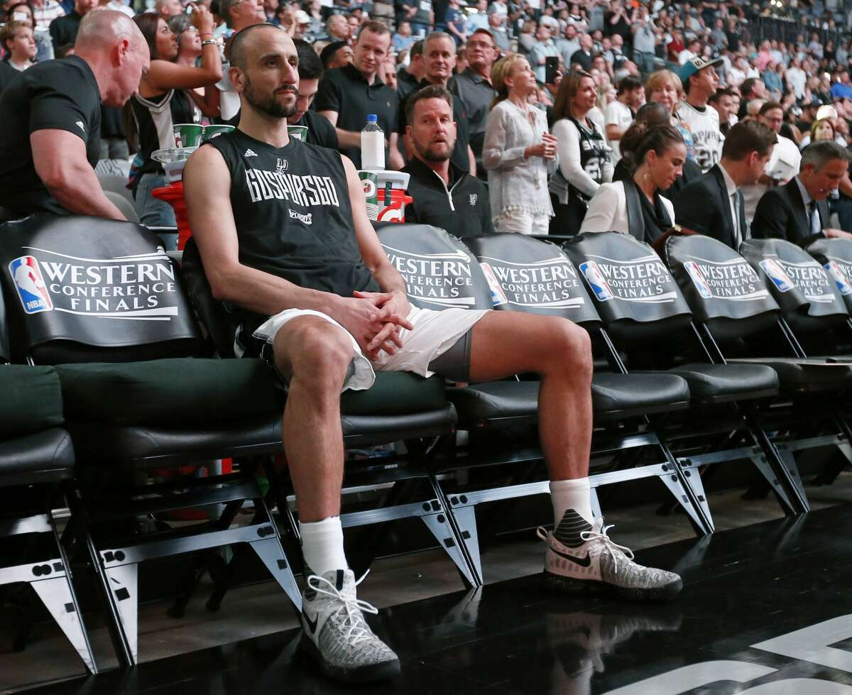 San Antonio Spurs' Manu Ginobili sits on the bench during introductions before Game 4 of the Western Conference Finals against the Golden State Warriors Monday May 22, 2017 at the AT&T Center.