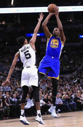 SAN ANTONIO, TX - MAY 22:  Kevin Durant #35 of the Golden State Warriors shoots the ball against Dejounte Murray #5 of the San Antonio Spurs in the first half during Game Four of the 2017 NBA Western Conference Finals at AT&T Center on May 22, 2017 in San Antonio, Texas. NOTE TO USER: User expressly acknowledges and agrees that, by downloading and or using this photograph, User is consenting to the terms and conditions of the Getty Images License Agreement.  (Photo by Ronald Martinez/Getty Images)
