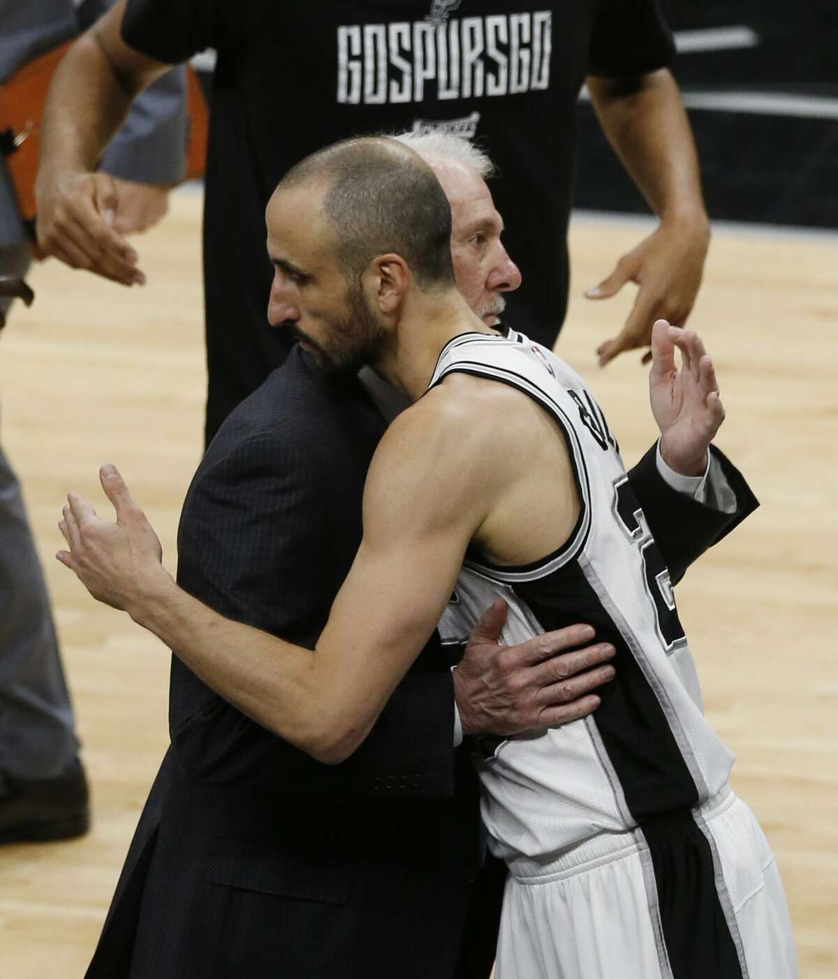 Spurs head coach Gregg Popovich gives Manu Ginobili (20) a hug as he he goes in as starter for Game 4 against the Golden State Warriors during the Western Conference Finals at the AT&T Center on Monday, May 22, 2017. (Kin Man Hui/San Antonio Express-News)