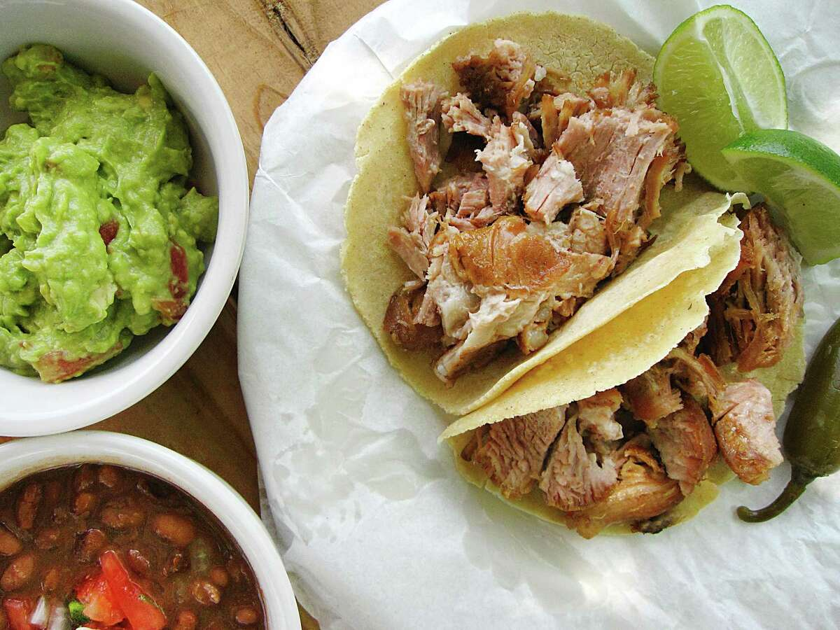 Carnitas tacos from Carnitas Lonja on Roosevelt Avenue. The taco shop has been named one of Eater's best new restaurants in the country.