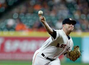 Houston Astros relief pitcher Brad Peacock (41) pitches during the first inning of an MLB baseball game at Minute Maid Park, Monday,  May 22, 2017. ( Karen Warren / Houston Chronicle )