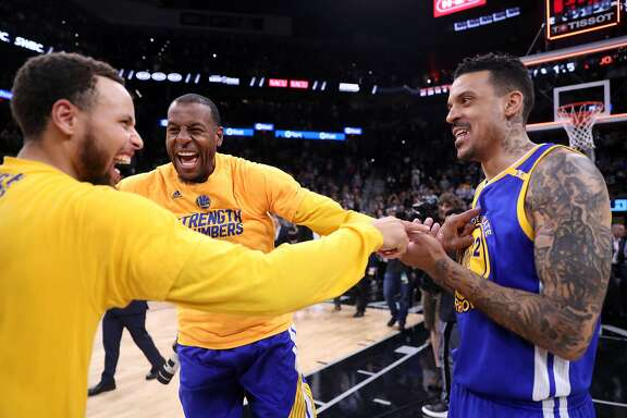 Golden State Warriors' Stephen Curry, Andre Iguodala and Matt Barnes react at end of Warriors' 129-115 win over San Antonio Spurs during Game 4 of NBA Western Conference Finals at AT&T Center in San Antonio, Texas, on Monday, May 22, 2017.