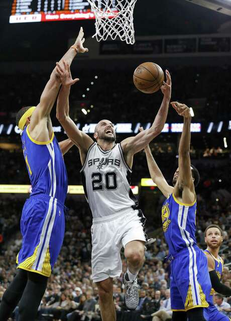 San Antonio Spurs' Manu Ginobili shoots between Golden State Warriors' JaVale McGee (left) and Shaun Livingston during first half action in Game 4 of the Western Conference Finals held Monday May 22, 2017 at the AT&T Center. Photo: Edward A. Ornelas, Staff / San Antonio Express-News / © 2017 San Antonio Express-News