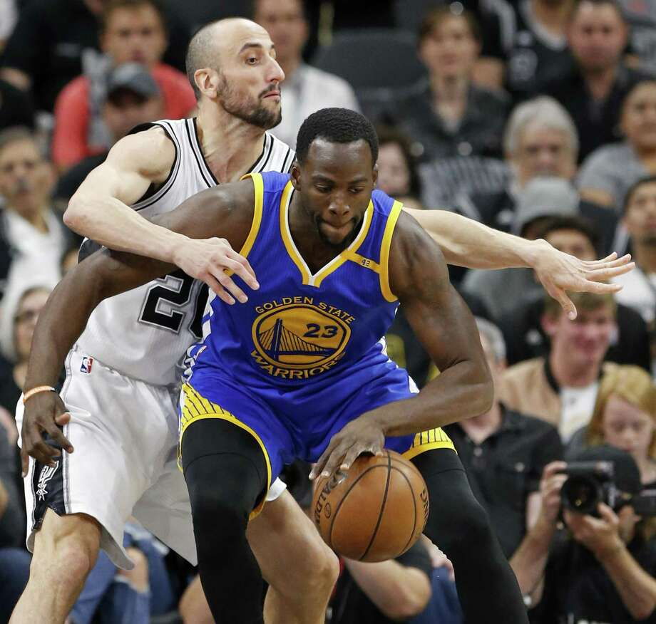 San Antonio Spurs' Manu Ginobili defends Golden State Warriors' Draymond Green during first half action in Game 4 of the Western Conference Finals held Monday May 22, 2017 at the AT&T Center. Photo: Edward A. Ornelas, Staff / San Antonio Express-News / © 2017 San Antonio Express-News