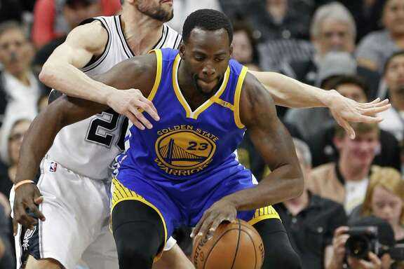 San Antonio Spurs' Manu Ginobili defends Golden State Warriors' Draymond Green during first half action in Game 4 of the Western Conference Finals held Monday May 22, 2017 at the AT&T Center.