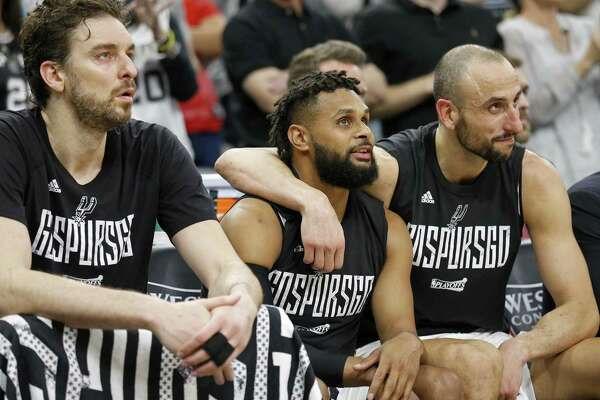 Spurs' Pau Gasol (from left), Patty Mills, and Manu Ginobili sit on the bench late in second half action in Game 4 of the Western Conference finals on May 22, 2017 at the AT&T Center.