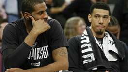 Spurs' LaMarcus Aldridge and Danny Green sit dejected on the bench late in Game 4 of the Western Conference finals against the Golden State Warriors on May 22, 2017 at the AT&T Center.