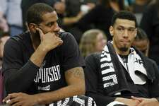 Spurs forward LaMarcus Aldridge (left) and guard Danny Green sit dejected on the bench late in Game 4 of the Western Conference finals against the Golden State Warriors on May 22, 2017 at the AT&T Center.