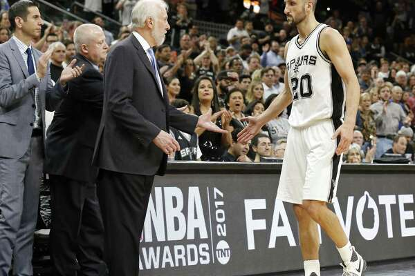 San Antonio Spurs' assistant coach James Borrego, head athletic trainer Will Sevening and head coach Gregg Popovich greet Manu Ginobili as he walks to the bench late in Game 4 of the Western Conference Finals against the Golden State Warriors Monday May 22, 2017 at the AT&T Center. The Warriors won 129-115.