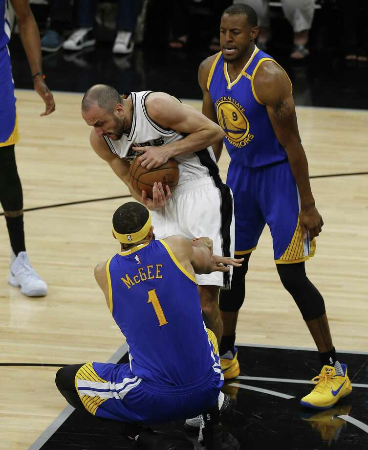 FILE – Spurs' Manu Ginobili (20) fights for the ball against Golden State Warriors' JaVale McGee (01) and Andre Iguodala (09) in Game 4 on the Western Conference Finals at the AT&T Center on in this file photo from Monday, May 22, 2017. Photo: Kin Man Hui, Staff / San Antonio Express-News / ©2017 San Antonio Express-News