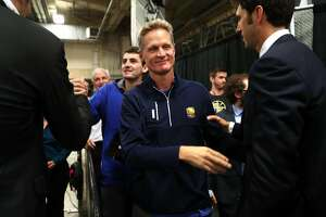 Golden State Warriors' head coach Steve Kerr greets Bob Myers after Warriors' sweep of San Antonio Spurs following 129-115 win during Game 4 of NBA Western Conference Finals at AT&T Center in San Antonio, Texas, on Monday, May 22, 2017.