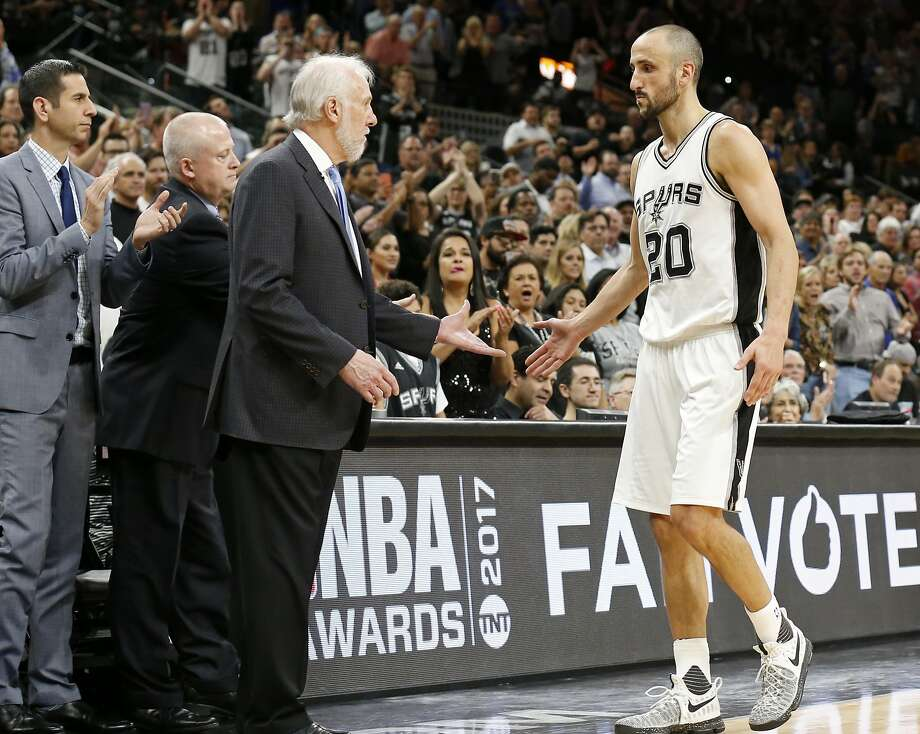 San Antonio Spurs' assistant coach James Borrego, head athletic trainer Will Sevening and head coach Gregg Popovich greet Manu Ginobili as he walks to the bench late in Game 4 of the Western Conference Finals against the Golden State Warriors Monday May 22, 2017 at the AT&T Center. The Warriors won 129-115. Photo: Edward A. Ornelas, San Antonio Express-News