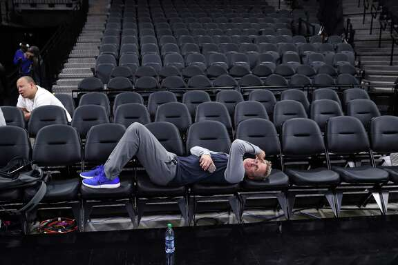 Golden State Warriors' head coach Steve Kerr rests after practice during NBA Western Conference Finals at AT&T Center in San Antonio, Texas, on Sunday, May 21, 2017.