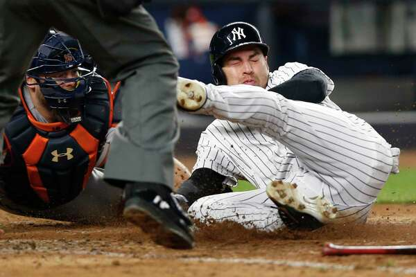 Houston Astros catcher Brian McCann, left, tags out New York Yankees' Jacoby Ellsbury at the plate for the final out of a baseball game in New York, Thursday, May 11, 2017. The Astros defeated the Yankees 3-2. (AP Photo/Kathy Willens)