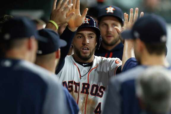 Houston Astros center fielder George Springer (4) celebrates his run scored on Houston Astros second baseman Jose Altuve's RBI double during the first inning of an MLB baseball game at Minute Maid Park, Monday,  May 22, 2017. ( Karen Warren / Houston Chronicle )