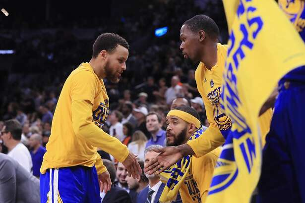SAN ANTONIO, TX - MAY 22:  Stephen Curry #30 high fives Kevin Durant #35 of the Golden State Warriors in the second half against the San Antonio Spurs during Game Four of the 2017 NBA Western Conference Finals at AT&T Center on May 22, 2017 in San Antonio, Texas. NOTE TO USER: User expressly acknowledges and agrees that, by downloading and or using this photograph, User is consenting to the terms and conditions of the Getty Images License Agreement.  (Photo by Ronald Martinez/Getty Images)