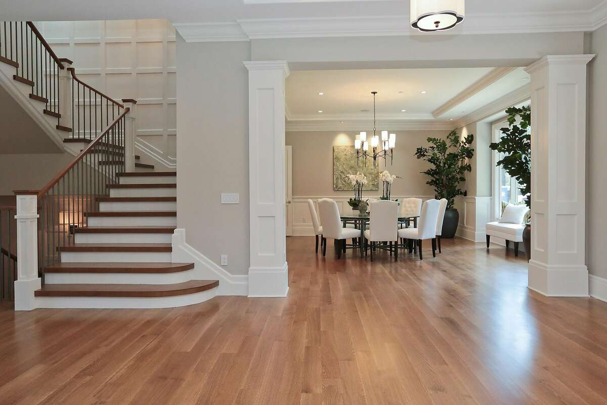 A dining room with waist-high wainscoting sits off the foyer.