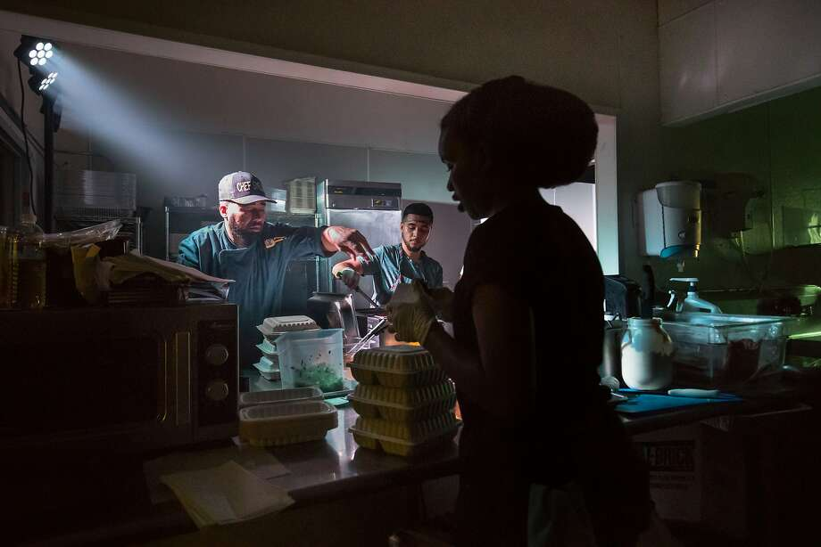 Edward Wooley (Chef Smelly), Juan Martinez and Indigo Burris-Albans working in the kitchen during one of their Friday night pop-up dinners in Oakland. Photo: Paul Kuroda, Special To The Chronicle