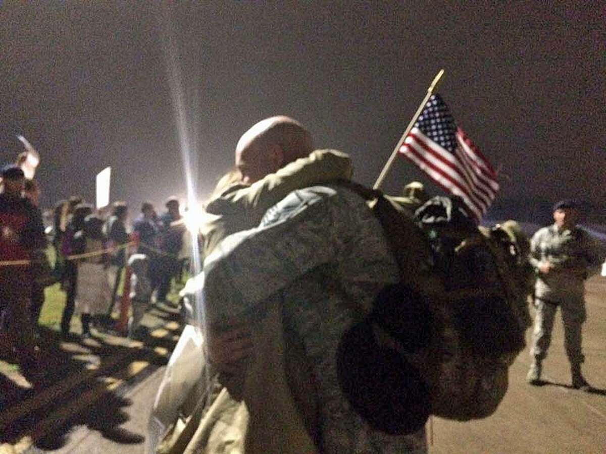 One hundred members of the Orange-based 103rd Air Control Squadron returned home on Monday night, May 22, 2017 after returning from duty in southwest Asia. Members from the Connecticut Air National Guard squadron were reunited with their families at the Bradley Air National Guard Base in East Granby.