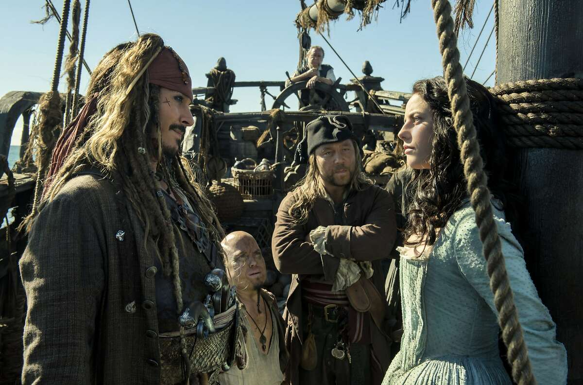 """In this image released by Disney, Johnny Depp portrays Jack Sparrow, left, and Kaya Scodelario portrays Carina Smyth, right, in a scene from """"Pirates of the Caribbean: Dead Men Tell No Tales."""""""