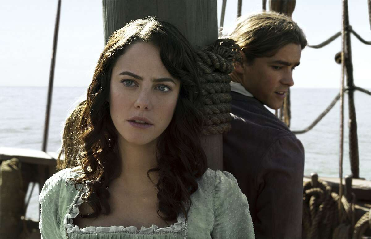 """In this image released by Disney, Kaya Scodelario portrays Carina Smyth, left, and Brenton Thwaites portrays Henry Turner in a scene from """"Pirates of the Caribbean: Dead Men Tell No Tales."""""""