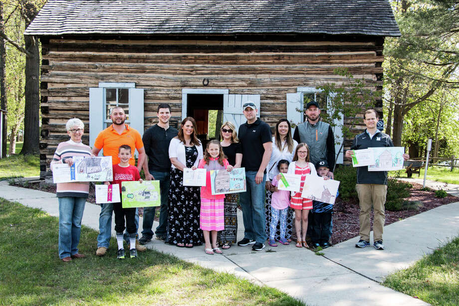 The Sanford Centennial Museum recently hosted the 2017 Log Cabin Day Art Contest. Pictured are the winners, all second graders from Meridian Elementary School, and their parents.