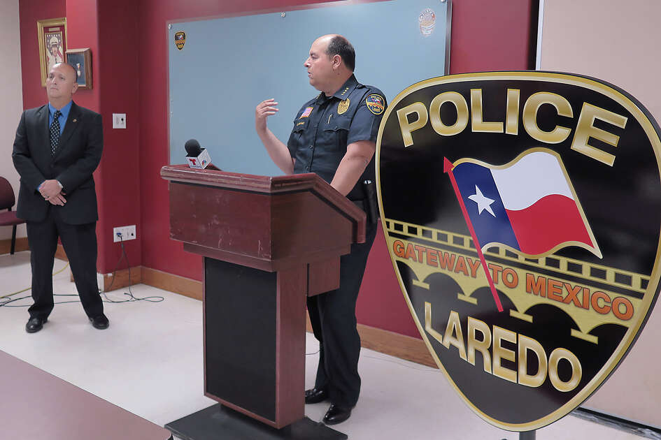 Laredo Police department PIO Joe Baeza, left, listens as acting Chief of Police Gabriel Martinez addresses members of the media, Monday, May 22, 2017 at the Laredo Police Department's Briefing Room, about an officer involved shooting incident.