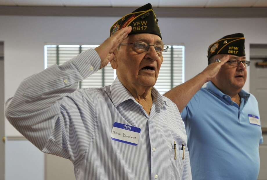 Chaplain Marco Pensiero, left, and Col. Bob Cody lead the room in the Pledge of Allegiance during the Springdale VFW Post 9617 anniversary picnic at the Belltown fire house in Stamford on Sunday, Aug. 11, 2013. Photo: Jason Rearick / Jason Rearick / Stamford Advocate