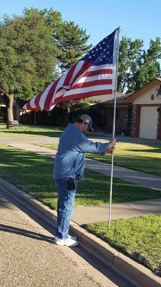 Brett Anderson, a member of the Plainview Elks Lodge, posts a flag last Saturday morning in observance of Armed Forces Day. Plainview Elks, along with Plainview Band Boosters, PHS Jr. Navy ROTC, Boy Scouts and Girl Scouts, post flags on eight holidays throughout the year as part of the Plainview Kiwanis Club's flag program. Flags will be posted again Monday for Memorial Day. To get a flag placed in front of your home or business (within Plainview city limits), send a $30 check to Kiwanis Flag Program, P.O. Box 684, Plainview, TX 79073.