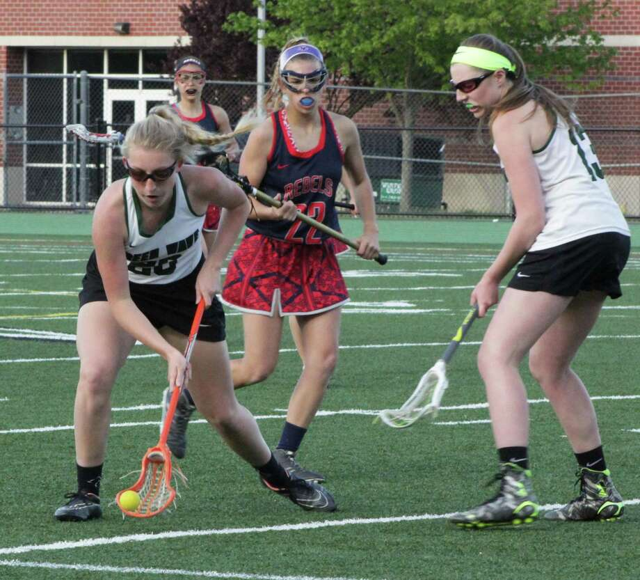 The New Milford High School girls varsity lacrosse team recently faced off against New Fairfield. The Green Wave beat New Fairfield 14-4. Above, senior Chloe Knight scoops up the ball. Photo: Courtesy Of Katie Alzapeidi / The News-Times Contributed