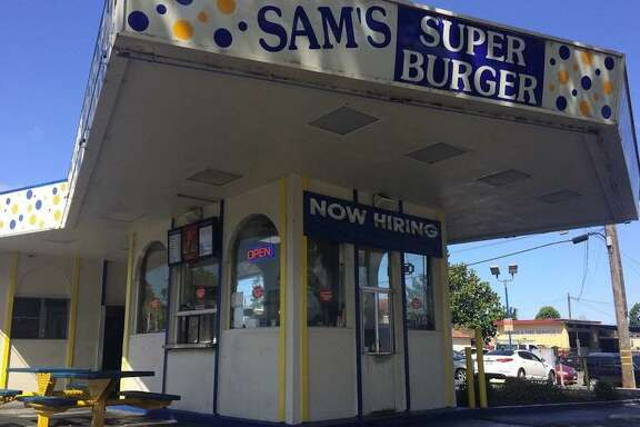A burger shop in San Leandro was robbed early Tuesday morning and one store employee was shot twice in the leg, officials said.