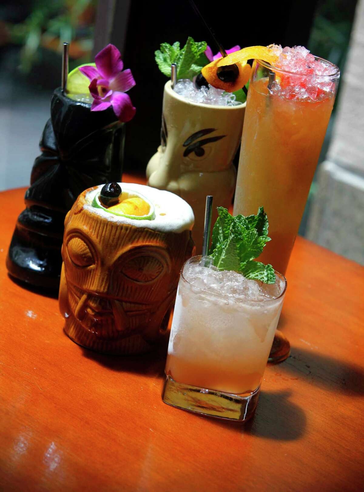 Saint City Supper Club's first annual Tiki Social will feature a cocktail social and a pig roast.