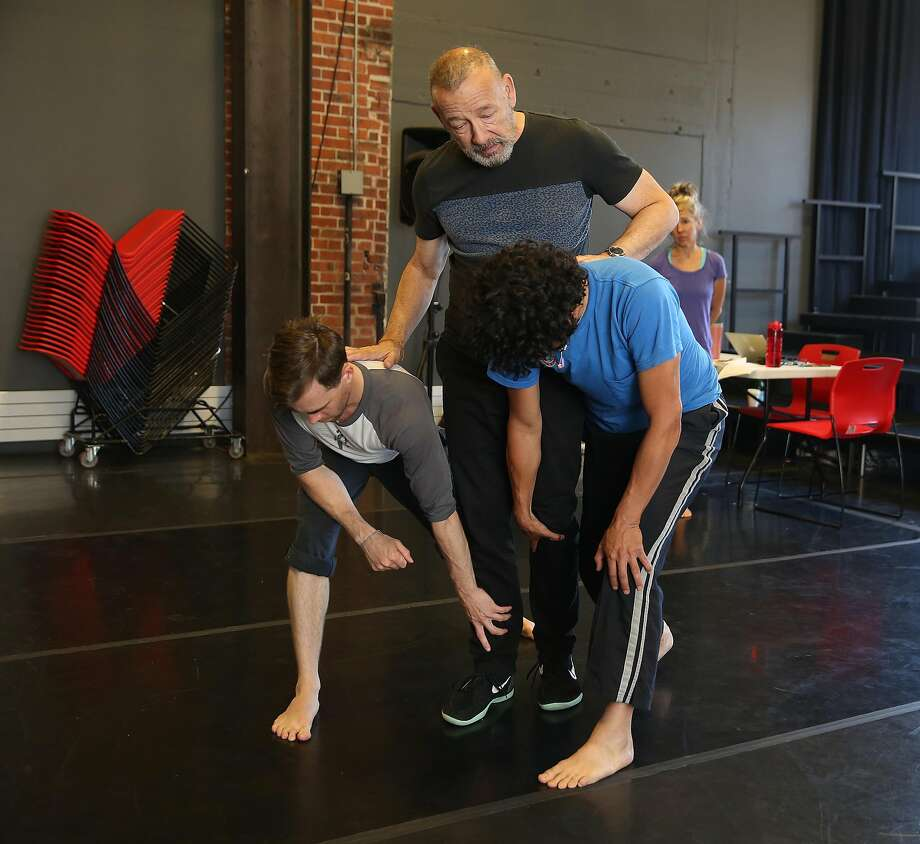 Choreographer Joe Goode  works with dancers  Andrew Ward and Felipe Barrueto-Cabello during the rehearsal of  'Nobody Lives Here Now' in it's 30th season on Monday, May 22, 2017,  in San Francisco, Calif. Photo: Liz Hafalia, The Chronicle