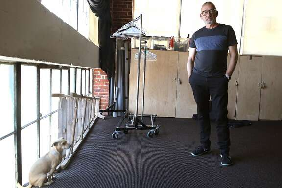 Choreographer Joe Goode in the storage room with his dog Macha on Monday, May 22, 2017,  in San Francisco, Calif.