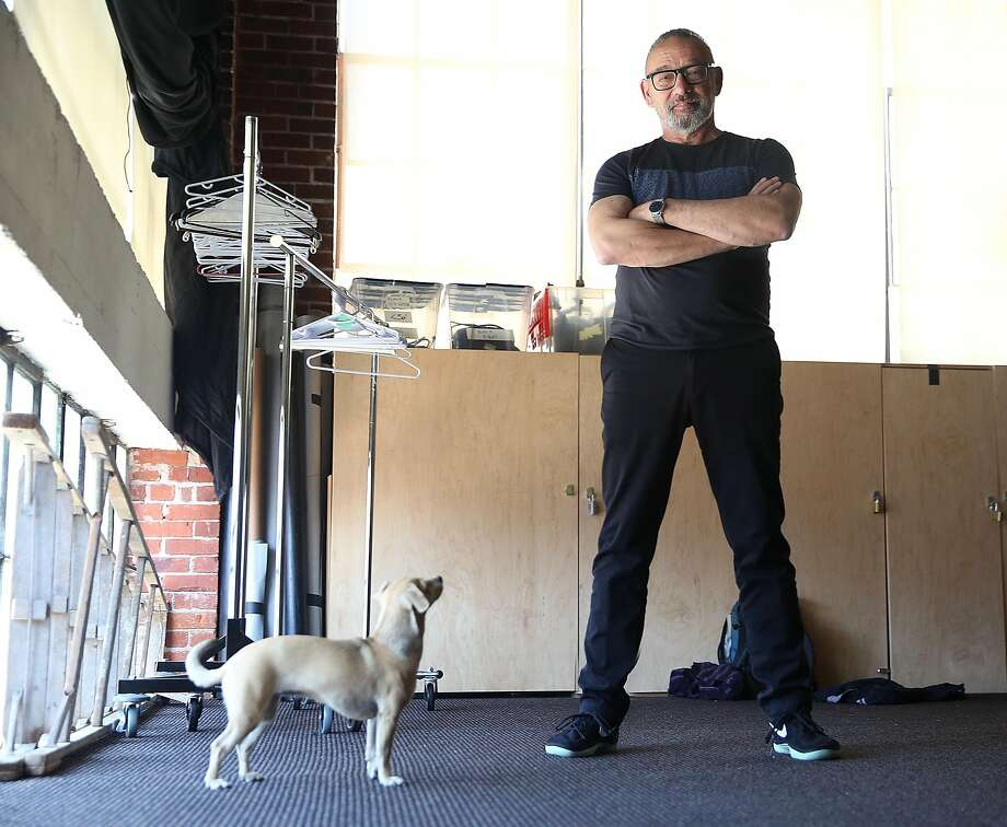Choreographer Joe Goode in the storage room with his dog Macha on Monday, May 22, 2017,  in San Francisco, Calif. Photo: Liz Hafalia, The Chronicle