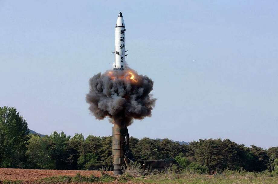 """TOPSHOT - CORRECTION - This undated picture released from North Korea's official Korean Central News Agency (KCNA) on May 22, 2017 shows North Korean ground-to-ground medium-to-long range strategic ballistic missile Pukguksong-2 being launched in a test-fire.    North Korea on May 22 declared its medium-range Pukguksong-2 missile ready for deployment after a weekend test, the latest step in its quest to defy UN sanctions and develop a weapon capable of striking US targets. / AFP PHOTO / KCNA VIA KNS / STR / South Korea OUT / REPUBLIC OF KOREA OUT   ---EDITORS NOTE--- RESTRICTED TO EDITORIAL USE - MANDATORY CREDIT """"AFP PHOTO/KCNA VIA KNS"""" - NO MARKETING NO ADVERTISING CAMPAIGNS - DISTRIBUTED AS A SERVICE TO CLIENTS THIS PICTURE WAS MADE AVAILABLE BY A THIRD PARTY. AFP CAN NOT INDEPENDENTLY VERIFY THE AUTHENTICITY, LOCATION, DATE AND CONTENT OF THIS IMAGE. THIS PHOTO IS DISTRIBUTED EXACTLY AS RECEIVED BY AFP.  / The erroneous mention[s] appearing in the metadata of this photo by STR has been modified in AFP systems in the following manner: [correcting source and restrictions]. Please immediately remove the erroneous mention[s] from all your online services and delete it (them) from your servers. If you have been authorized by AFP to distribute it (them) to third parties, please ensure that the same actions are carried out by them. Failure to promptly comply with these instructions will entail liability on your part for any continued or post notification usage. Therefore we thank you very much for all your attention and prompt action. We are sorry for the inconvenience this notification may cause and remain at your disposal for any further information you may require.STR/AFP/Getty Images Photo: STR, Stringer / AFP/Getty Images / AFP"""