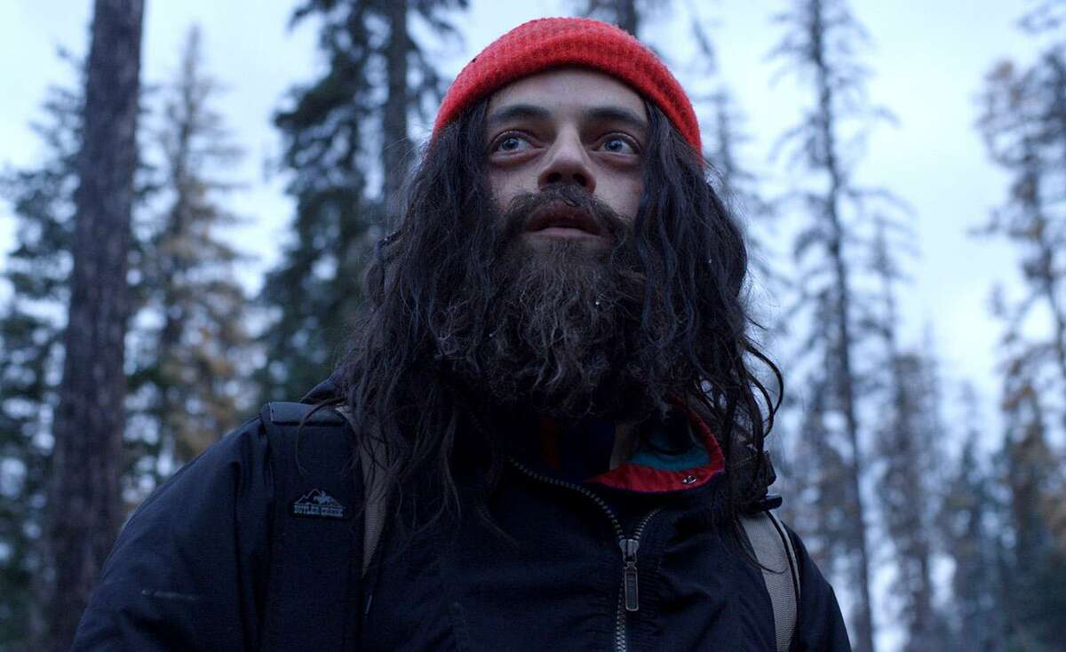 Buster (Rami Malek) checks out of the straight world in in