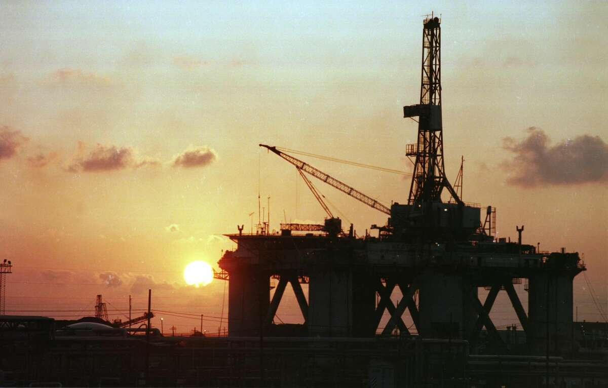 Offshore drilling is nothing new in Texas. The sun sets behind one of the three floating rigs that Texas Drydock upgraded for Diamond Offshore Drilling in Port Arthur in 1998.