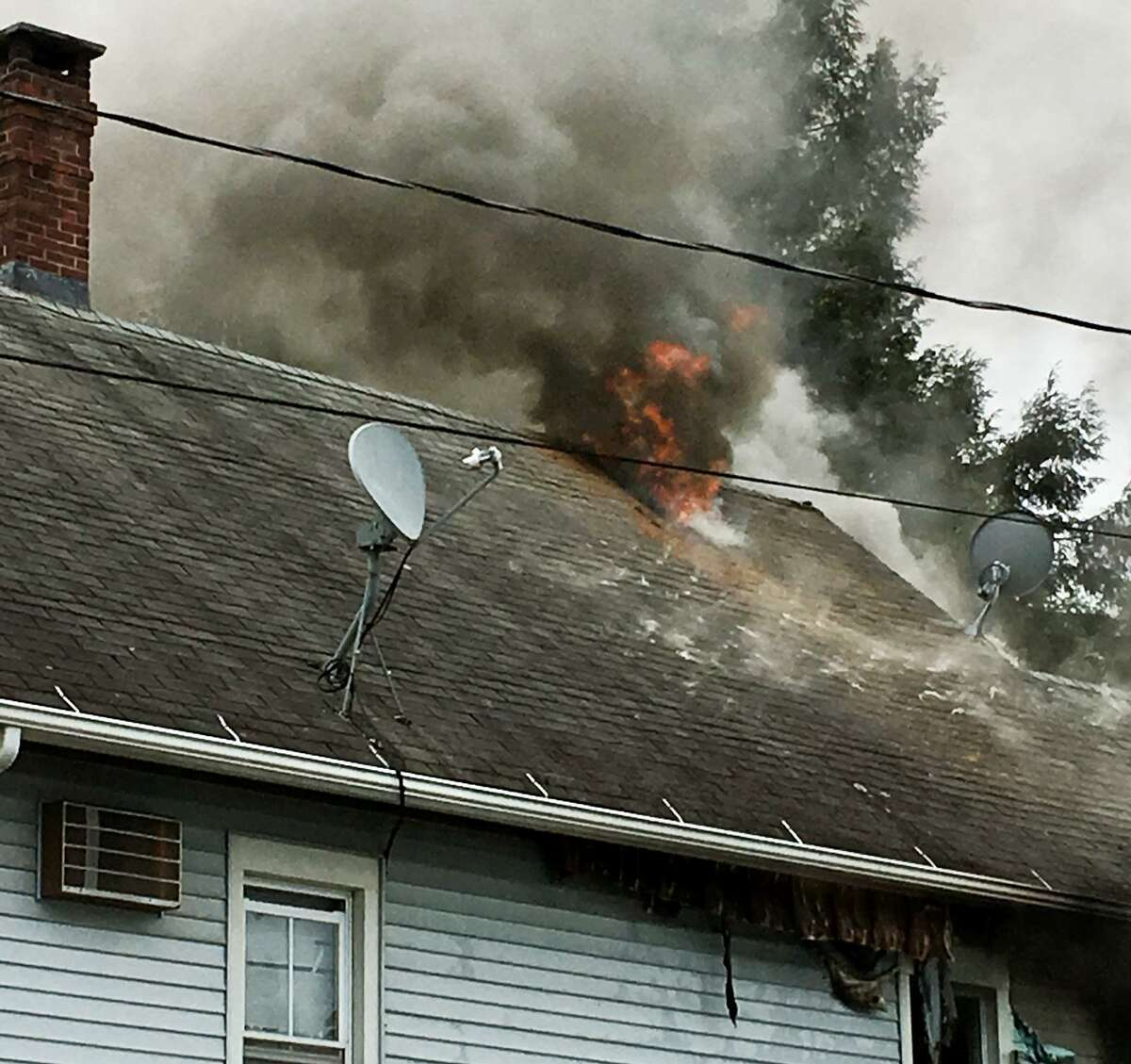 Firefighters are responded to a two-alarm blaze at a house on Hubbell Street between Sixth Street and Seventh Street in Ansonia, Conn. on Tuesday, May 23, 2017.