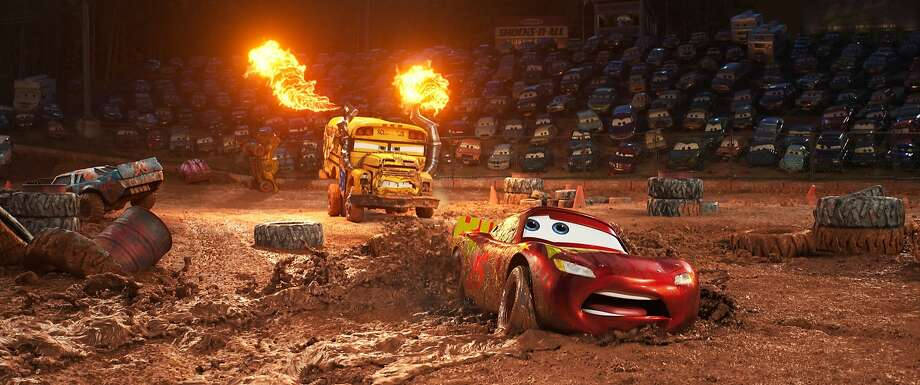 "A demolition derby scene in ""Cars 3"" has Miss Fritter (left), voiced by Lea DeLaria, bearing down on Owen Wilson's Lightning McQueen. The film opens at Bay Area theaters on June 16. Photo: Walt Disney Pictures"