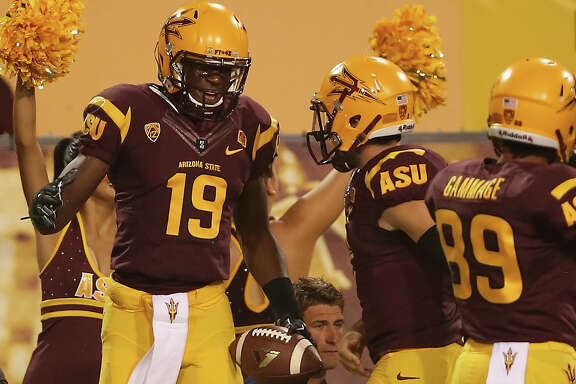 TEMPE, AZ - AUGUST 28:  Wide receiver Ellis Jefferson #19 of the Arizona State Sun Devils celebrates with quarterback Mike Bercovici #2 after scoring a 15 yard touchdown reception against the Weber State Wildcats during the third quarter of the college football game at Sun Devil Stadium on August 28, 2014 in Tempe, Arizona.  (Photo by Christian Petersen/Getty Images)