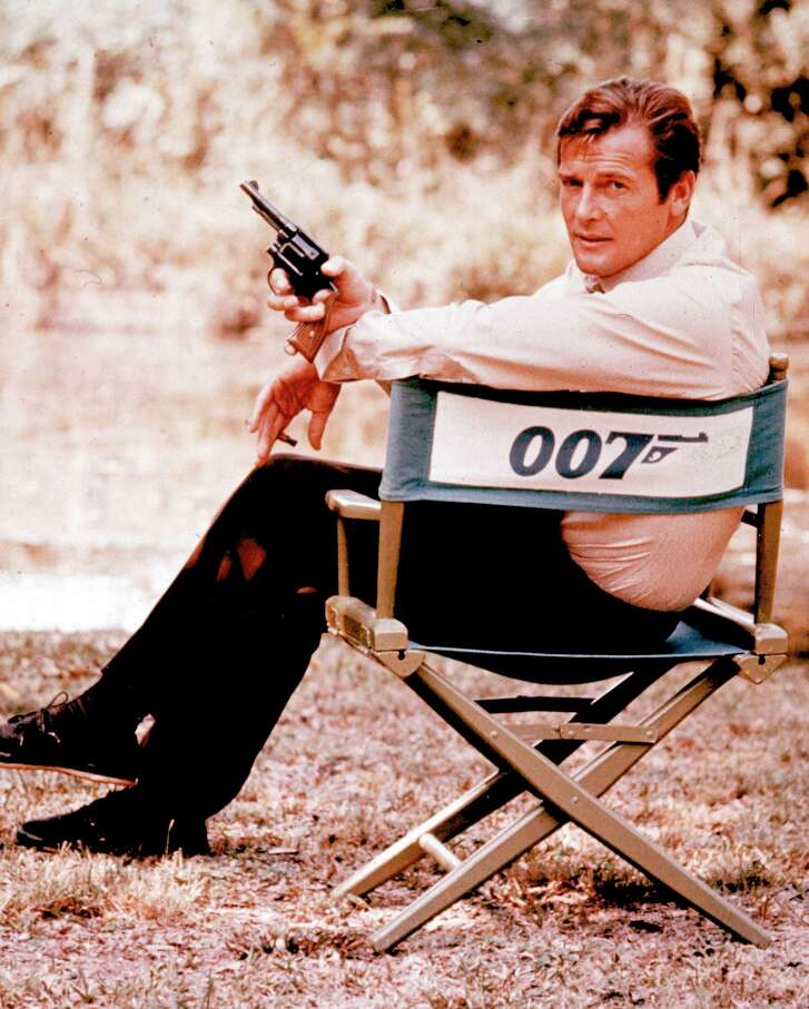 FILE - British actor Roger Moore, playing the title role of secret service agent 007, James Bond, is shown on location in England in 1972. Moore, played Bond in seven films, more than any other actor.  Roger Moore's family said Tuesday May 23, 2017 that the  former James Bond star has died after a short battle with cancer  (AP Photo, File) ORG XMIT: LON136
