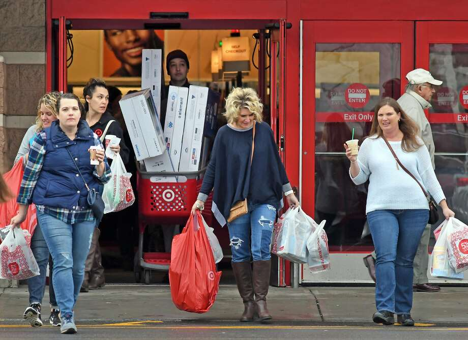 Black Friday shoppers at Target in 2016. On Tuesday, the company reached a settlement over a 2013 data breach that affected tens of millions of customers. Photo: Michael P. Farrell, Albany Times Union