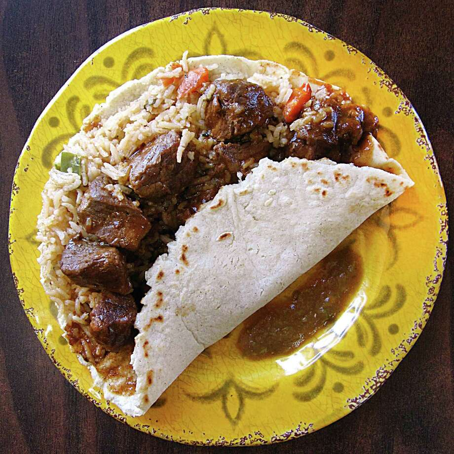 Carne guisada taco with rice on a handmade corn tortilla from Teran's Restaurant. Photo: Mike Sutter /San Antonio Express-News