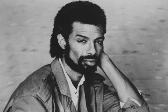 """In the Sept. 1984 file photo, musician Gil Scott-Heron poses. Scott-Heron, who helped lay the groundwork for rap by fusing minimalistic percussion, political expression and spoken-word poetry on songs such as """"The Revolution Will Not Be Televised"""" but saw his brilliance undermined by a years-long drug addiction, died Friday, May, 27, 2011 at age 62. (AP Photo, File)"""