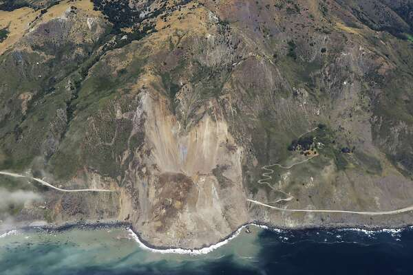 In this aerial photo taken Monday, May 22, 2017 provided by John Madonna showing a massive landslide along California's coastal Highway 1 that has buried the road under a 40-foot layer of rock and dirt. A swath of the hillside gave way in an area called Mud Creek on Saturday, May 20, covering about one-third of a mile, half a kilometer, of road and changing the Big Sur coastline. (John Madonna via AP)