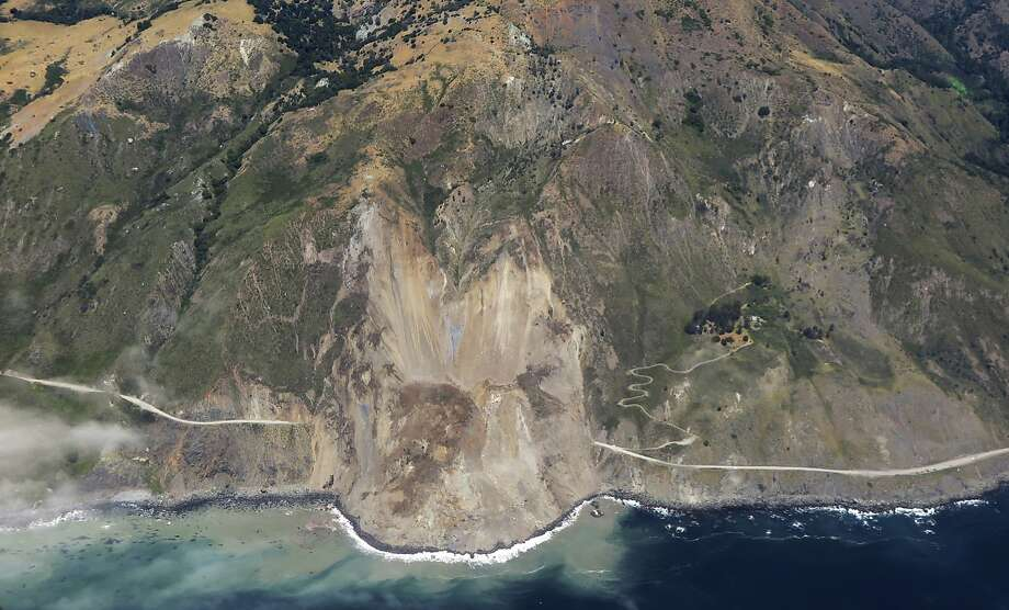 This aerial photo taken Monday, May 22, 2017, and provided by John Madonna, shows a massive landslide along California's coastal Highway 1 that has buried the road under a 40-foot layer of rock and dirt. A swath of the hillside gave way in an area called Mud Creek on Saturday, May 20, covering about one-third of a mile, half a kilometer, of road and changing the Big Sur coastline. Photo: John Madonna, Associated Press