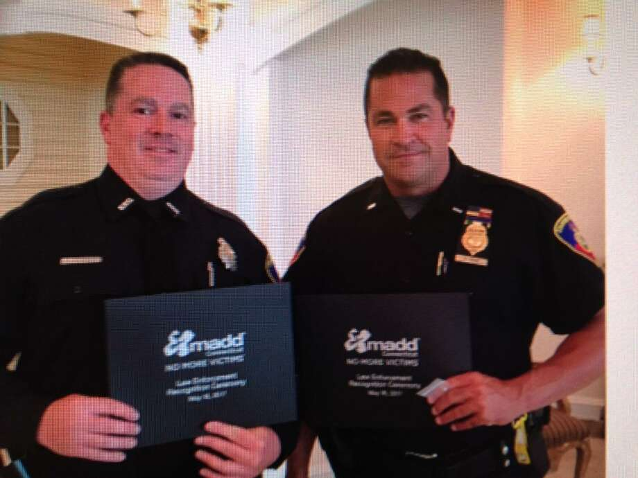 Stamford police Officer Jeffrey Booth and Lt. Diedrich Hohn receive awards from Mothers Against Drunk Driving during an award ceremony last week. Photo: MADD / Contributed