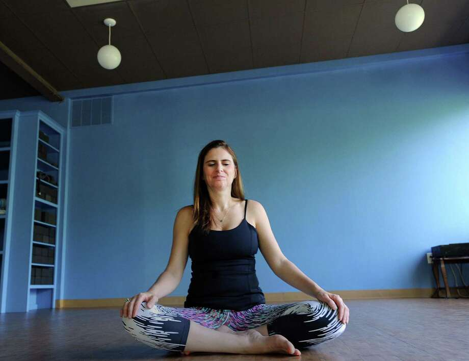 Kaia Yoga owner Gina Norman practices yoga at her business in Old Greenwich, Conn., Thursday, May 18, 2017. Photo: Bob Luckey Jr. / Hearst Connecticut Media / Greenwich Time